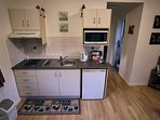 Inside the cottage, showing the kitchenette area.