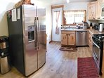 Stainless steel appliances, water cooler and door to back yard.