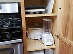 Cabin has muffin pan, colander, cutting board, crock pot, blender and cooler.