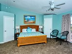 Master bedroom has a king-size bed, floor-to-ceiling sliders opening to private veranda, HDTV, en suite 2-person jetted...