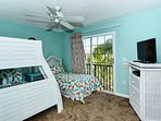3rd bedroom has a full/twin-size bunk plus an additional twin bed with floor-to-ceiling sliders with a view of the pool...