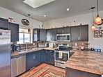 The modern kitchen features stainless steel appliances and ample counter space.