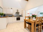 Kitchen fully fitted with dishwasher, microwave, oven and hob.
