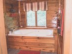 Enjoy soaking in your huge double sized whirlpool tub for 2 with a beautiful view.