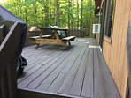 Large deck area with gas grill and seating