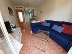 Salón con sofá chaiselong