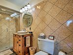 Freshen up before a day at the wineries in this lavish bathroom.
