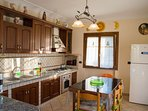 The fully equipped kitchen with a big fridge and freezer, microwave,large stove,mocha coffe maker...