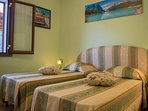 The second bedroom with two singles beds, which on request can be prepared also as a double bed