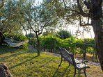 The front garden with its view of the sea it is equipped with benches, small table, and hammock