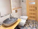 Bathroom. Shower, washing machine, wc / bidet.