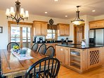 Spacious kitchen with stainless steel appliances and granite counter tops.