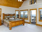 Upstairs King Master Bedroom with Private balcony, en suite, fireplace and 49' Smart HDTV.