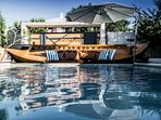 Old vintage fishing boat by the pool