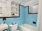 1950s Mid-Century Sky Blue Shower Tile Bathroom - Furnished Apartments in Atlanta - Cool Classic Studios On 25th