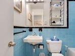 1950s Mid-Century Sky Blue Tile Bathroom and Vanity - Short Term Housing Atlanta - Cool Classic Studios On 25th