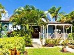 Chattel house style villa with wraparound veranda