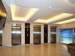 The lobby in Patong Tower, with 3 well maintained lifts
