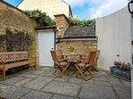 The stable door in the kitchen leads out into the attractive courtyard garden...