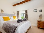 The stunning master bedroom, with a double bed
