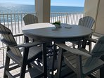 View of the Gulf from the balcony and new furniture.  Enjoy a meal or play games with stunning views