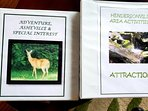 There are binders with rack cards and brochures to help you plan your Activities and Adventures!