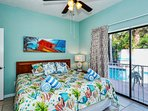 Bedroom with king-size bed, flat panel HD TV, sliders opening to the pool..