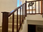 Stairs leading to master suite and rooftop veranda