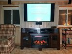 ENTERTAINMENT CENTER ,VHS/DVD, BLUERAY DVD, SURROUND SOUND STEREO, AND FIREPLACE