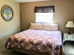 bedroom with king bed and 1/2 bath en suite