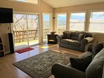 open concept living room with beautiful views (electric fireplace no longer there)