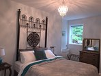 Bedroom with Antique Gate Headboard