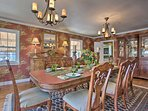 This home features beautiful wallpaper and elegant furnishings.