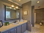 Primp and pamper in the master bathroom before heading to a winery nearby.