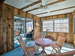 Chat with a friend over a morning cup of joe in the home's sunroom.