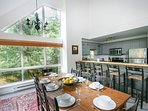 Open plan dining/kitchen w/ breakfast bar