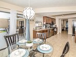 Gather around our dinette area right off the kitchen and steps from the Patio  / Swimming Pool!