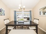 Dining Room with sliding glass doors to the Pool/Patio!