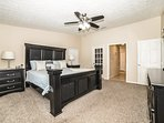 Master Bedroom with King Size Bed ensuite bathroom with sliding glass door to patio / pool.