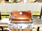 Awesome weber grill right off the swimming pool!