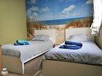 Habitación  camas individuales TV