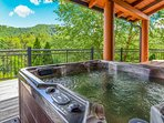 Two hot tubs with mountain views