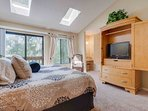 Upstairs master bedroom. King bed, balcony access and private en suite bath.