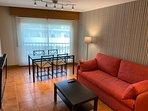 Salón-Comedor con sofá-cama de dos camas individuales