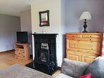 Wood burning stove in sitting room.