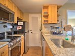Fully equipped, the kitchen has everything you need for homemade meals.