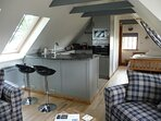 Breakfast area with fully equipped kitchen dishwasher microwave hob oven fridge freezer toaster etc