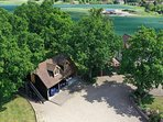 Aerial view of accommodation and side stairs to this peaceful secluded property..Plenty of parking
