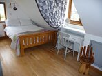 Comfortable oak double bed with privacy curtain and reading lamp