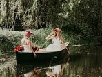 guests in canoe on pond